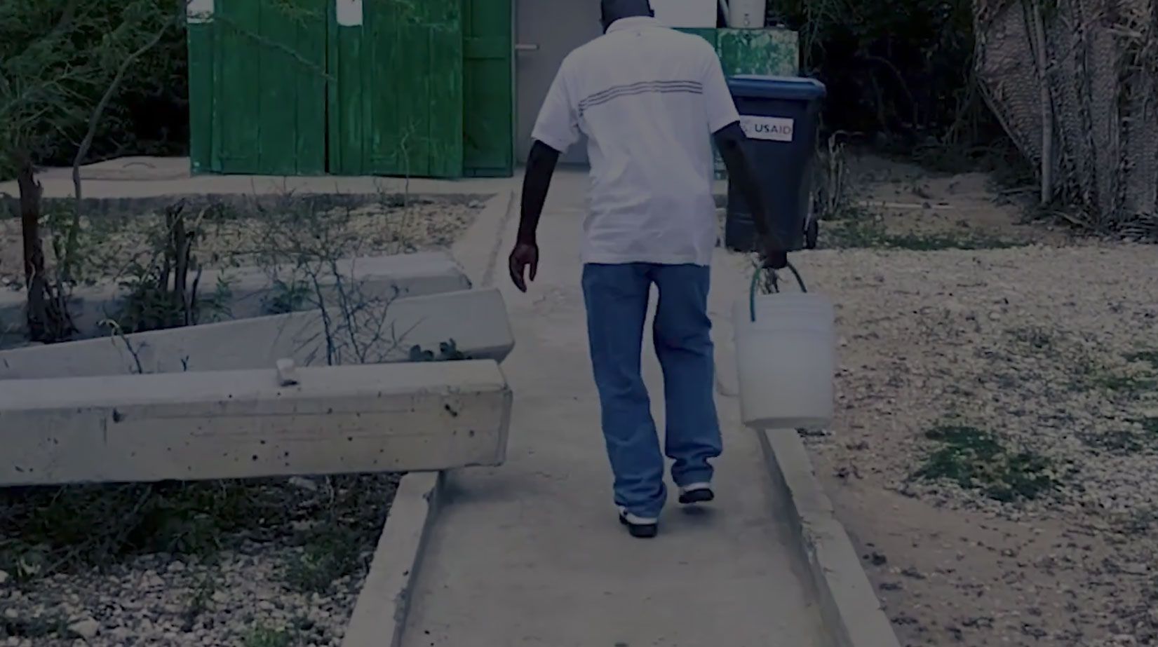 A man carrying a bucket of water