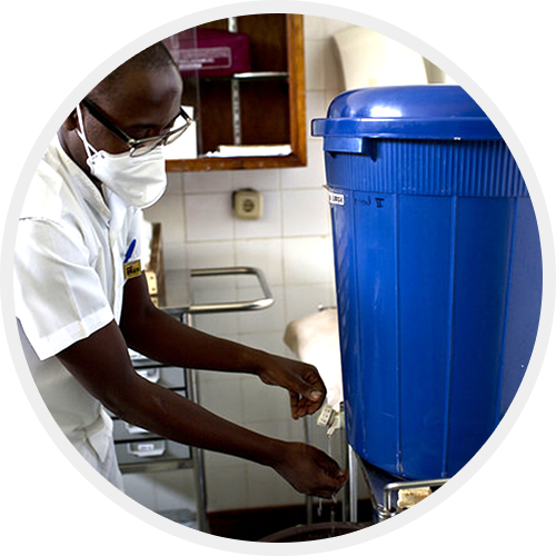 A healthcare worker washing his hands