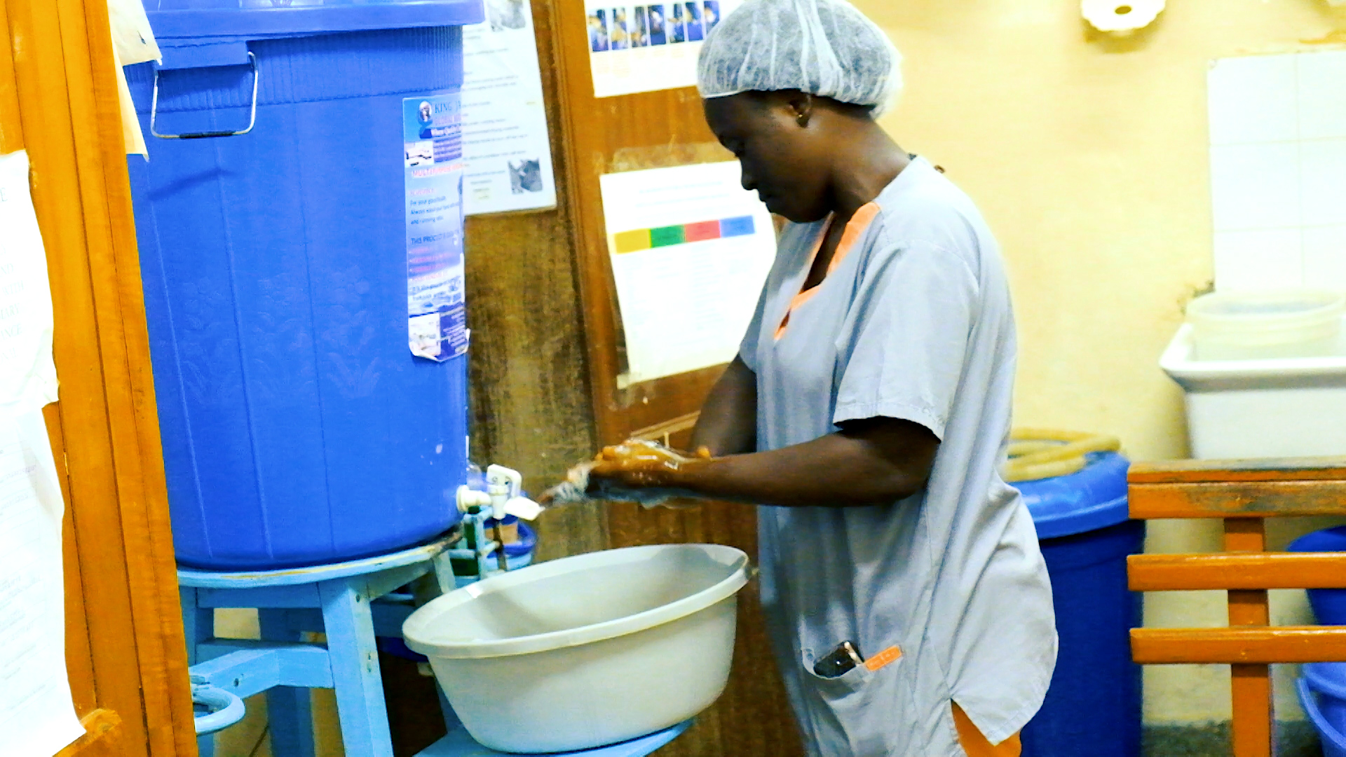 A healthcare worker washing her hands